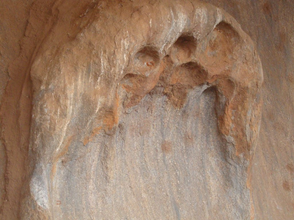 Close up of dimples on the side of Ayers Rock