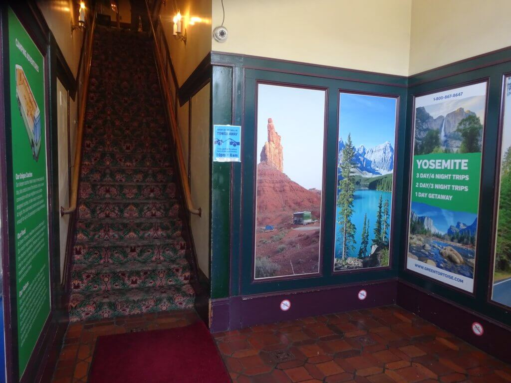 Adverts of tours available to book in the entrance to the Green Tortoise Hostel in San Fran