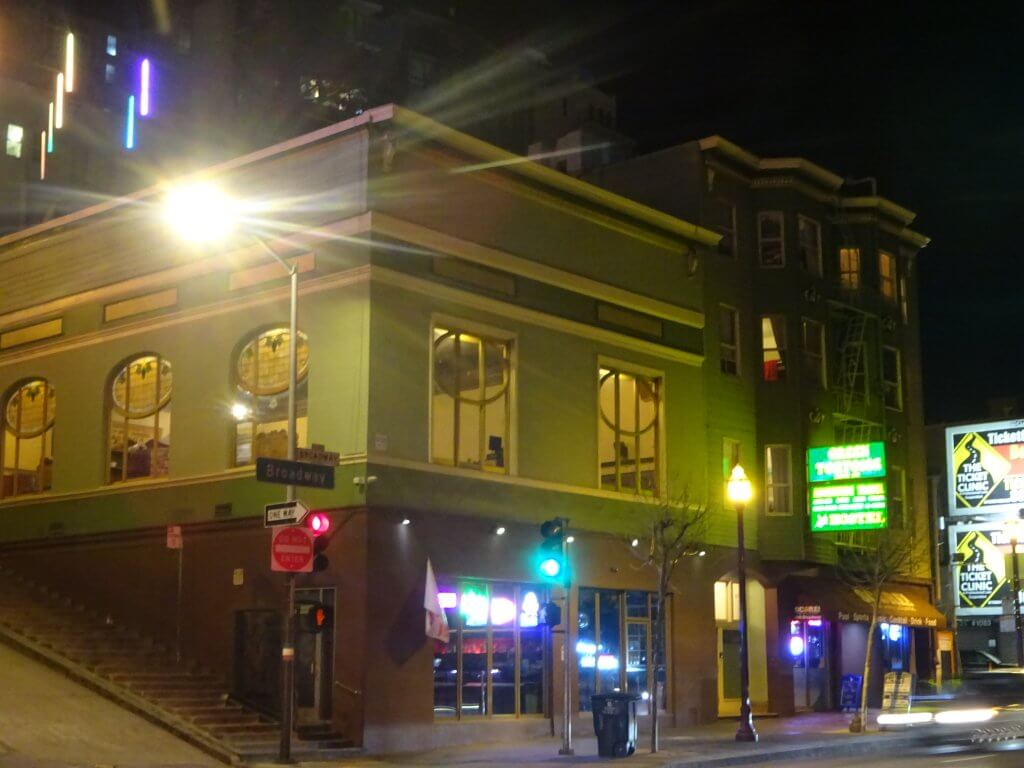 Outside the Green Tortoise Hostel in San Francisco at night.