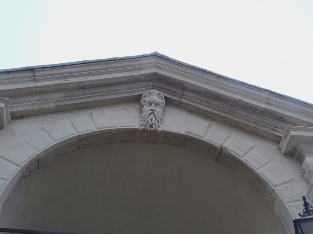 Relief Of A Face On The Central Portico Of Rialto bridge