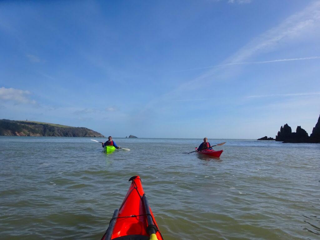 Two Kayaks On The Sea