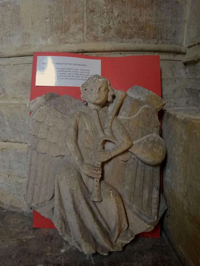 Stone Carving Of A Bagpiping Angel