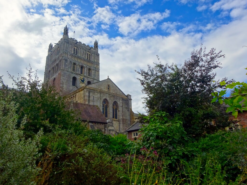 Tower Of Tewkesbury Abbey Overshadowing Trees