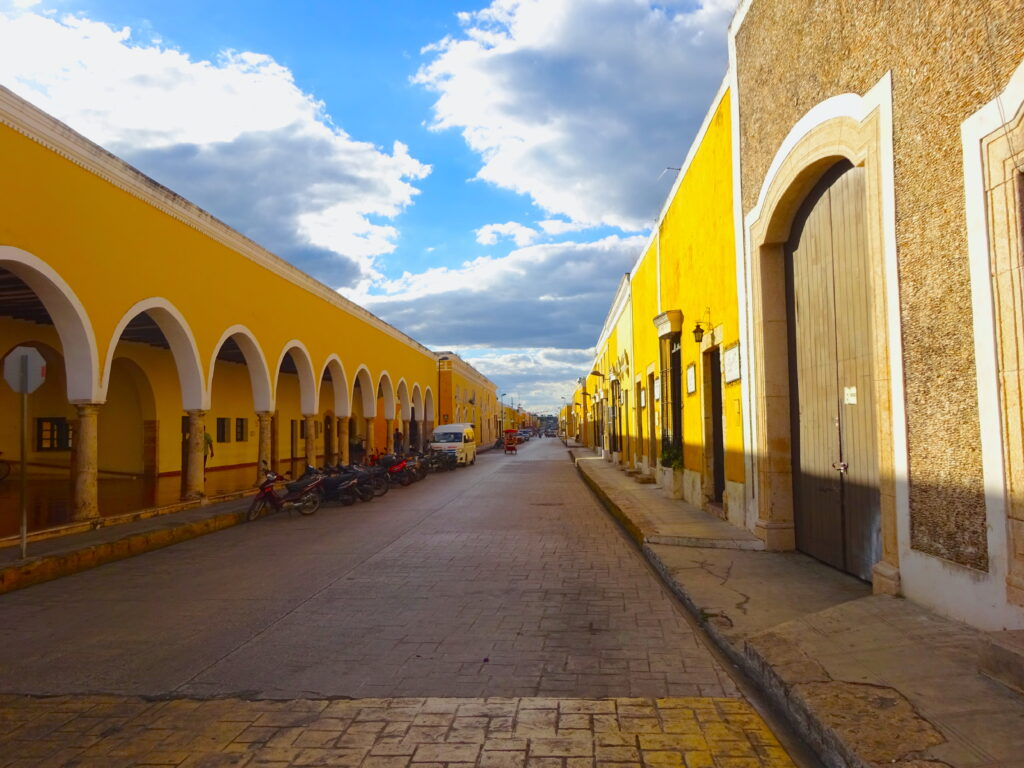 Yellow Buildings On Street