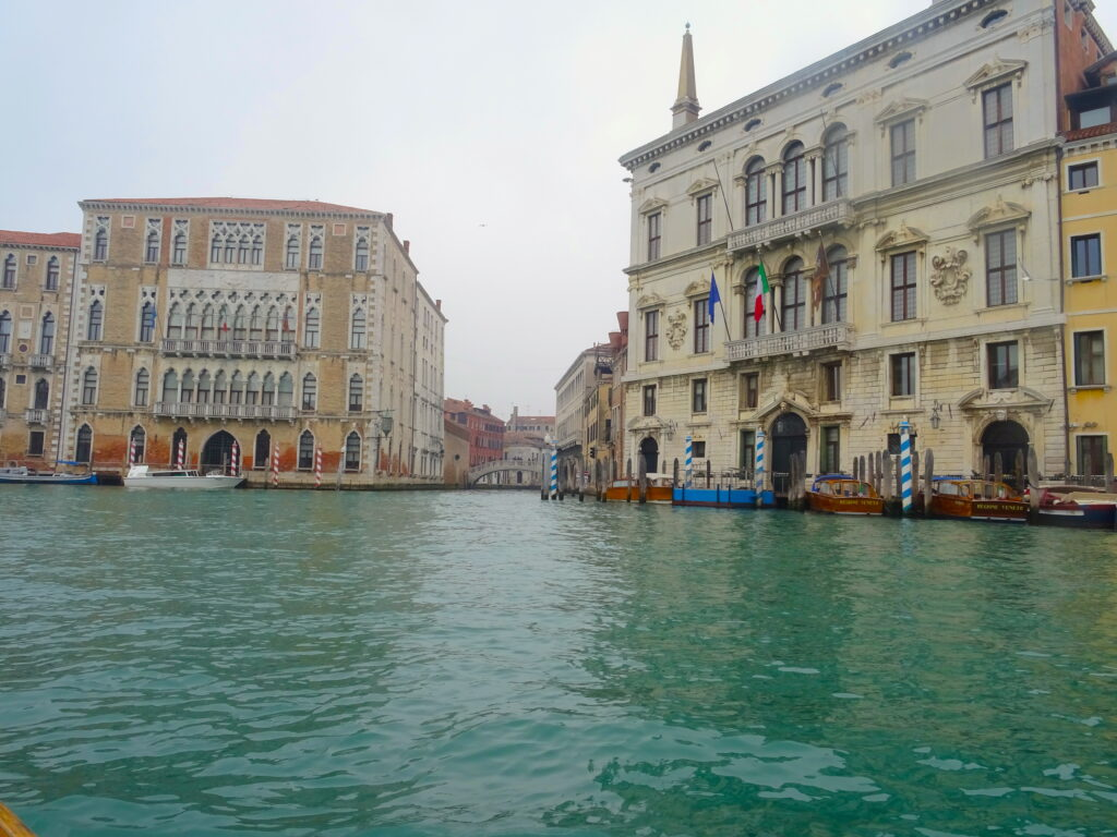 A Canal Junction In Venice Seen From The Water