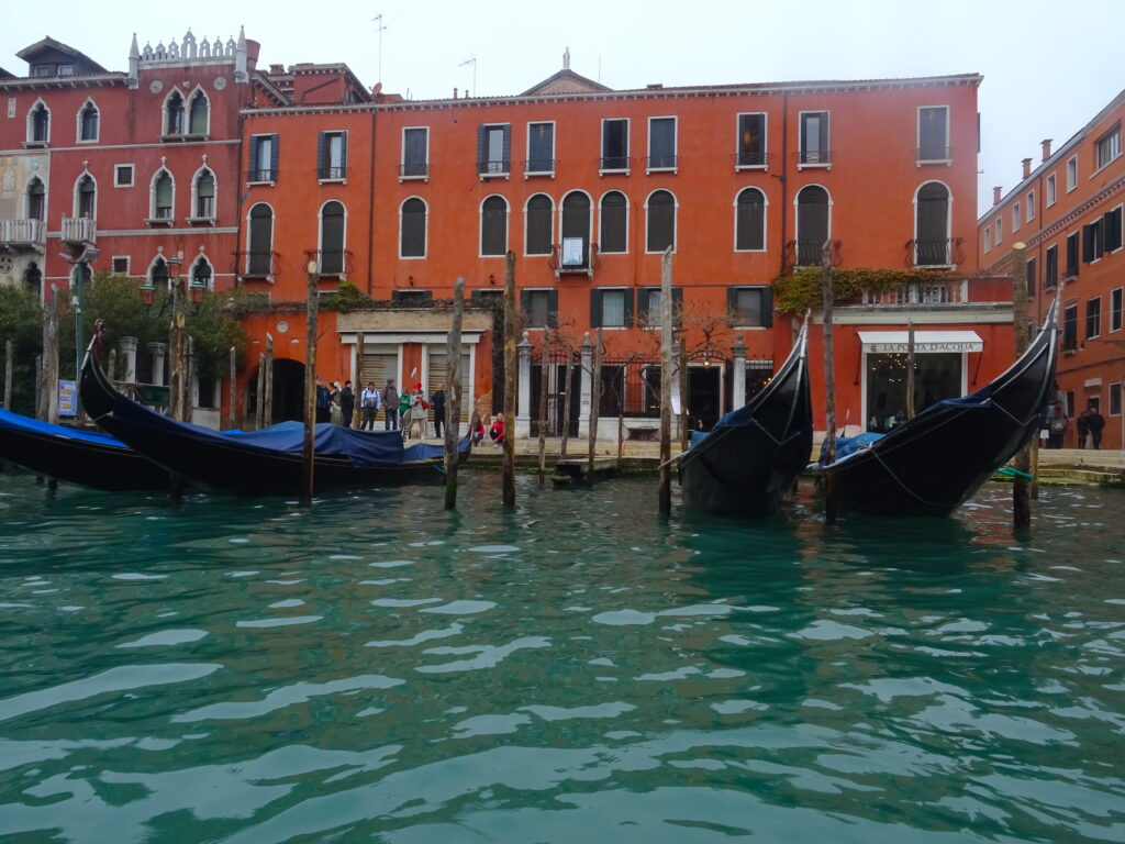 Docked Gondolas Seen From The Water