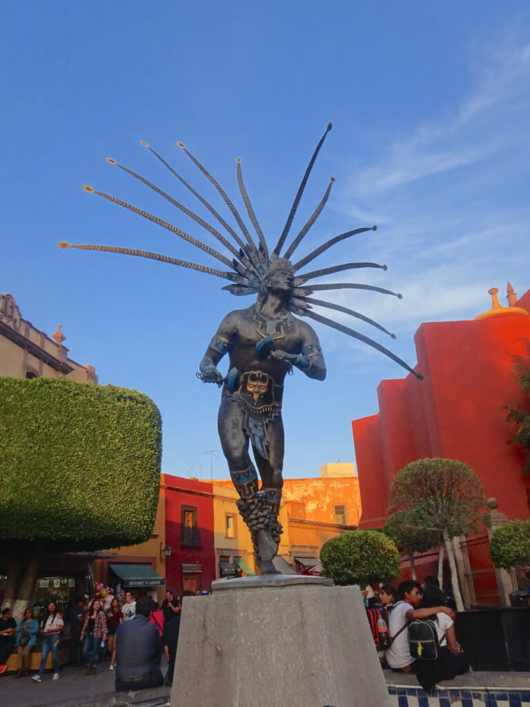 Statue Of Native Mexican With Large Headdress In Querétaro