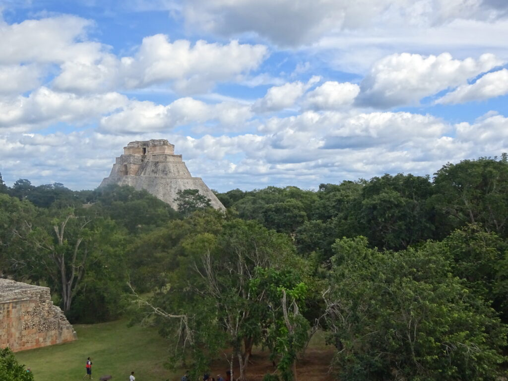 Pyramid Of The Magician Rising Out From Trees At Uxmal
